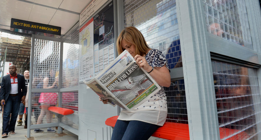 Reading the paper at the Regents Street Lego Bus Stop