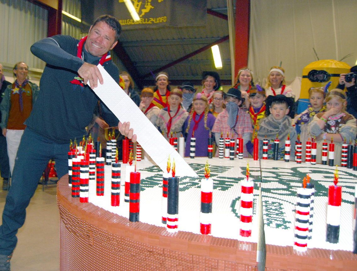 Adventurer Steve backshall cutting cub scouts cake